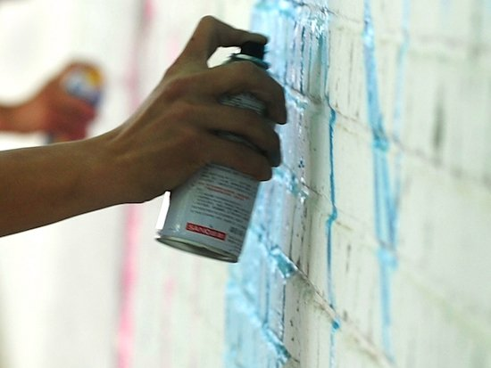 Graffiti sprayed on wall